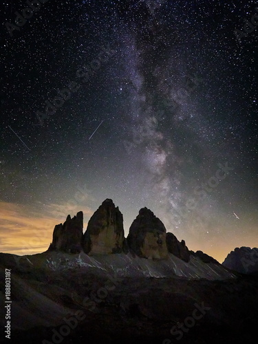 Fotografie, Obraz  Alps Mountain landscape with night sky and Mliky way Tre Cime di Lavaredo, Dolom