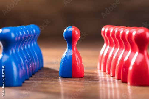 Fotografie, Obraz  Merging Of Red And Blue Pawns
