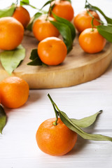 Mandarin Oranges on rustic white wooden background