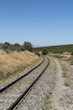 Riebeek West in the Swartland region of South Africa. December 2017. Single railway track running through countryside and vines at Riebeek West.