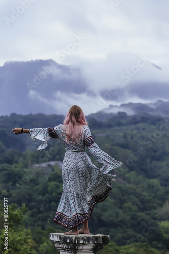 Indonesia, Bali, young woman standing on base