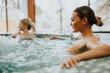 Leinwandbild Motiv Young woman relaxing in the whirlpool bathtub