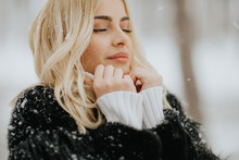Blonde Woman Outside In Snow Winter Coat