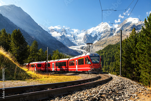 train in the scenic swiss alps around bernina and moteratsch glacier
