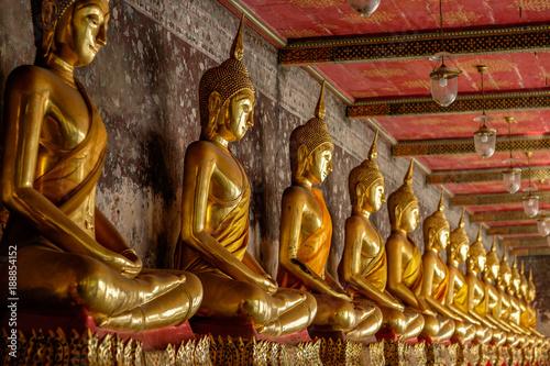 Obraz na plátně  Row of golden buddha at thai temple in Bangkok, Thailand.