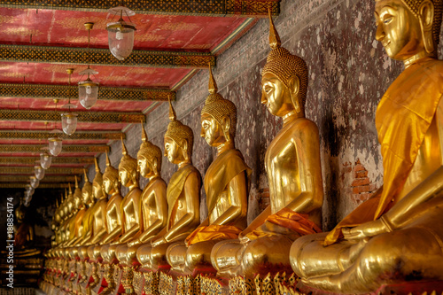 Obraz na plátně  Row of golden buddha at thai temple in Bangkok, Thailand.