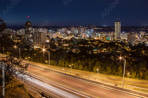 Downtown skyline and light trails from cars at night in Hamilton, Ontario Wallpaper Mural