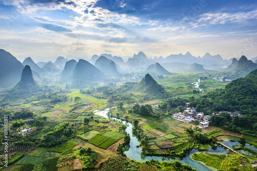 Photo Stands Guilin Landscape of Guilin, Li River and Karst mountains. Located near Yangshuo, Guilin, Guangxi, China.
