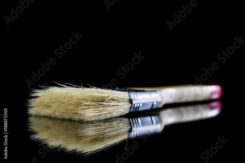 Foto op Aluminium Ree A paintbrush for a painter on a glass table. Painting accessories in a mirror reflection.