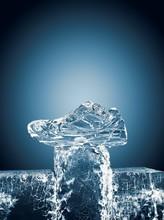 Block Of Ice On Blue Background