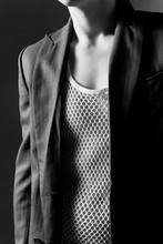 Midsection Of Man Wearing Mesh Tank Top And Blazer