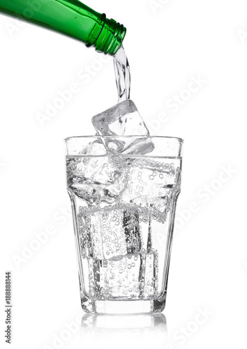 Photo  Pouring lemonade soda drink from bottle to glass