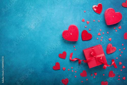 Valentines day background with gift box and red hearts. Top view. Flat lay style.