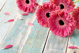 Deep color bouquet from beautiful gerbera daisy flowers on vintage wooden background. Greeting card for mother or womans day..