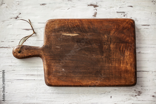 Chopping board on vintage white wooden background