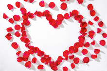 Heart Of Red Rose Petals On Wh...