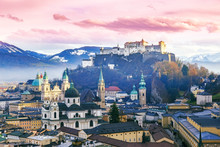 Salzburg, Austria. Sunset Scenery In Winter From Above. View Of The Historic City Of Salzburg With Salzburg Cathedral And Famous Festung Hohensalzburg In Christmas Time In Winter, Salzburger Land.