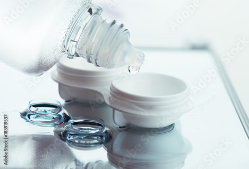 Bottle with lens solution and case on table #188919537