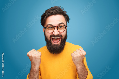 Poster  Excited man with fists up