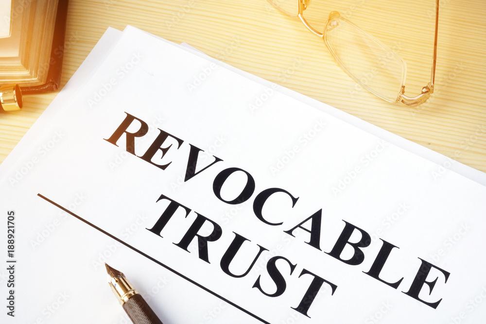 Fototapeta Revocable trust on a wooden desk.