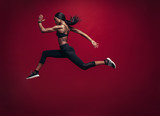 Female athlete running and jumping - 188924551