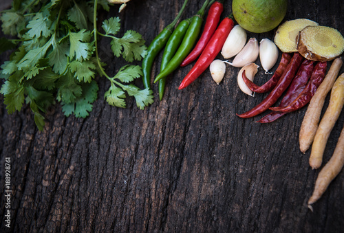 Poster Aromatische Ingredients of Thai spicy food on wooden board