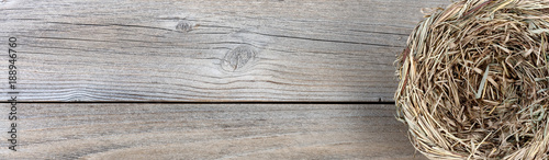 Fototapeta Natural bird nest on weathered wooden boards obraz