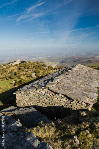 Upper View On Ancient Stone Sheep Barn And Atlantic Coastline In Blue Sky Basque Country