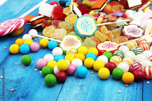 Keuken foto achterwand Snoepjes candies with jelly and sugar. colorful array of different childs sweets and treats on light blue wood background