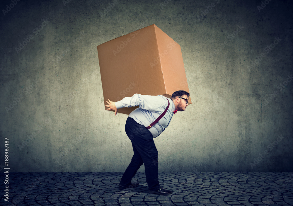 Fototapety, obrazy: Man carrying heavy box on back