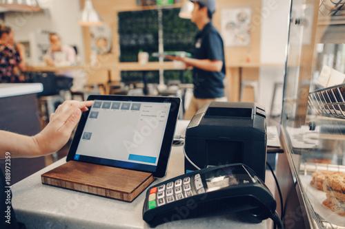 Valokuvatapetti Closeup shot of caucasian cashier hands