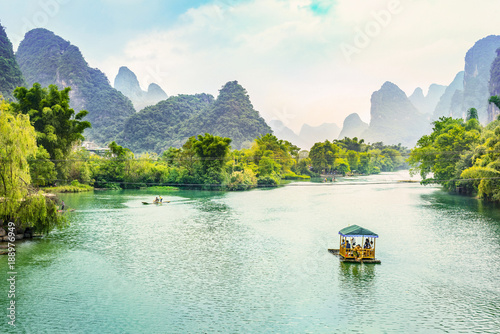 Photo Stands Guilin Landscape of Guilin, Li River and Karst mountains. Located in Yangshuo, Guilin, Guangxi, China.