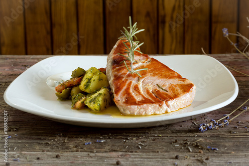 Tuna Steak with Fried Potatoes. On a wooden background. rustic food