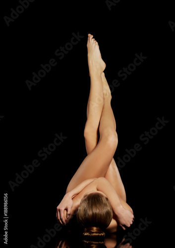 Fotografie, Obraz  Beautiful woman's long shaved legs. Vertical view.