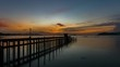 old small jetty in to the sea in sunrise or sunset evening time