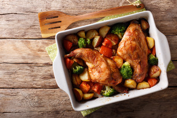 Homemade dietary rabbit baked with vegetables close-up in a baking dish. horizontal top view