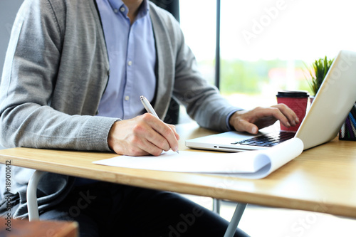 Photo  Businessman hands pointing at business document. Closeup.