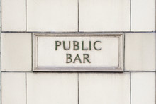 Pub Public Bar Sign On White Brick Background