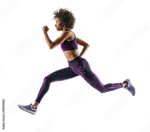 Young african girl running in silhouette on white background Canvas Print
