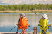 Children With Fishing Rods Sit...