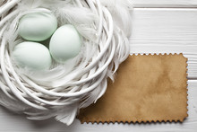 Three Easter Eggs In The Nest And Blank Handmade Paper Sheet
