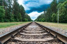 Rusty Railroad With Rocks In T...