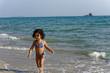 little girl on the beach in summer Thailand