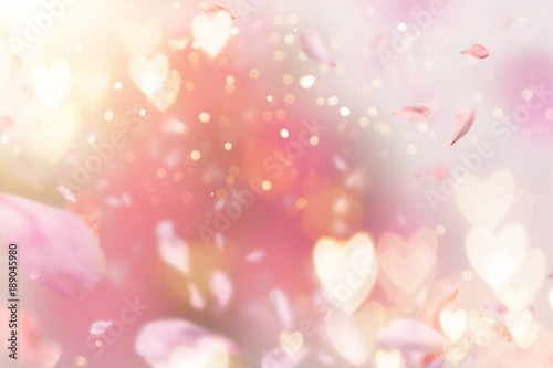 Abstract composition for Women's Day. Pink flower petals flying with hearts symbols.