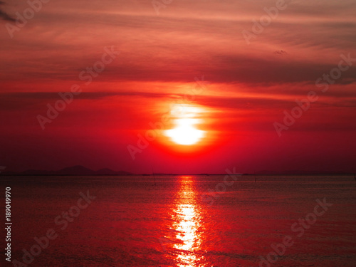 Tuinposter Baksteen sunset sundawn on the sea and evening cloud sky