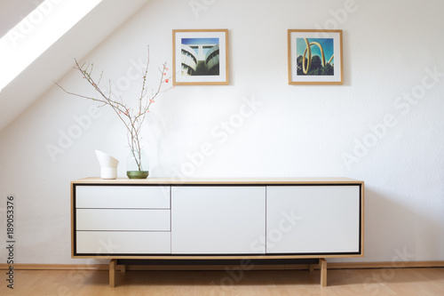 Modern sideboard in bright living room Canvas-taulu