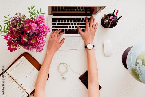 Obraz Woman working on a desktop computer from above - fototapety do salonu