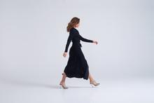 Woman Wearing Long Black Dress...
