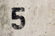 Number 5 Five Black Sign On Concrete Wall Closeup With Copyspace