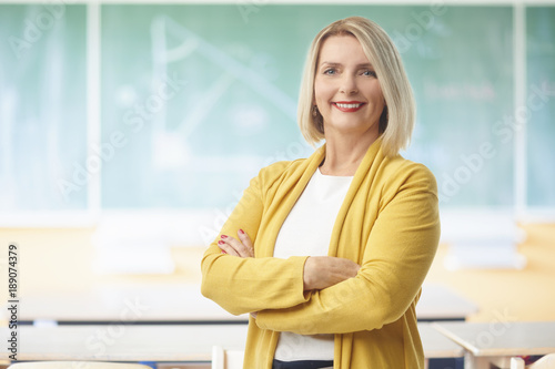 Female teacher in the classroom Poster Mural XXL